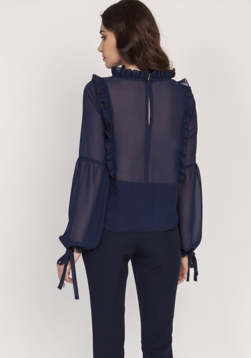 A subtle blouse with frills. BLU143 navy